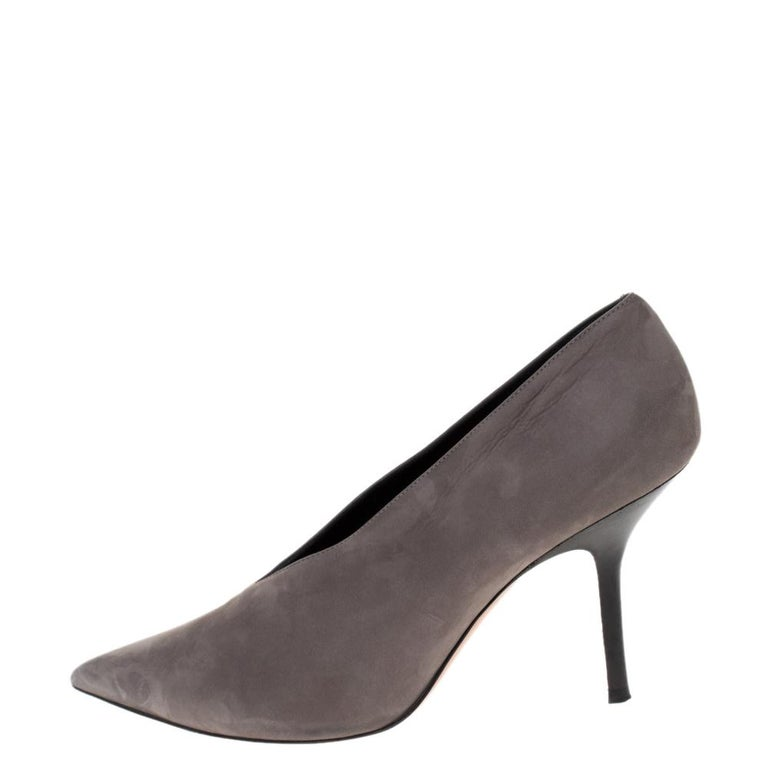 You are sure to fall head over heels in love with this pair of V Neck pumps from Celine. These stylish pumps will add a touch of elegance to any outfit. Crafted in Italy, they are made from quality nubuck leather and come in a shade of grey. They