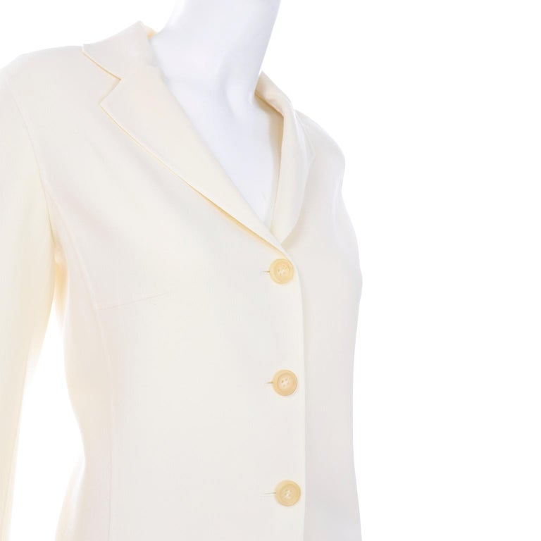 This is a really lovely creamy ivory Celine skirt and jacket suit with pretty seam details. We love this suit because the fabric  is super soft and lightweight, so it's a great option for warmer climates! You can wear the pieces as separates with