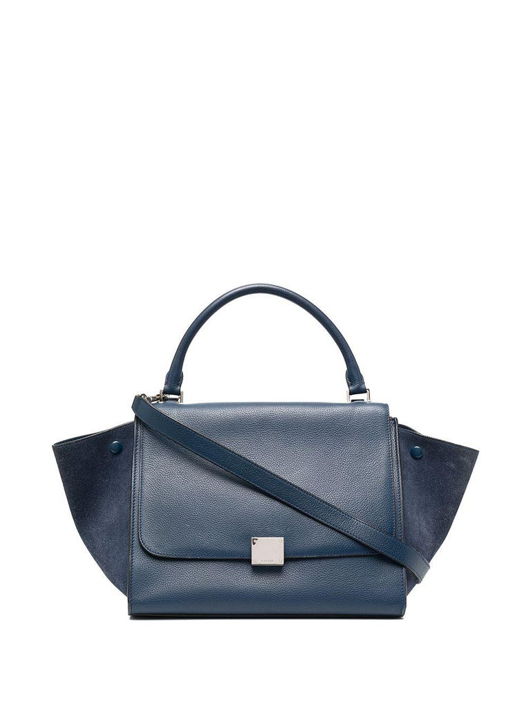 Celine blue leather & suede Trapeze Medium size tote bag featuring a single rounded top handle, a foldover top,  an adjustable detachable shoulder strap, an internal patch pocket, a rear zip-fastening pocket and silver-tone hardware. In excellent