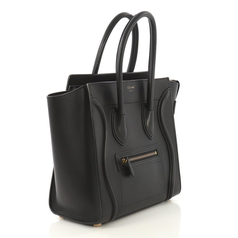 This Celine Luggage Handbag Smooth Leather Micro Crafted In Black Features Dual