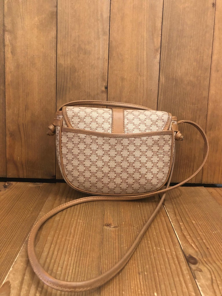 """CELINE Macadam Canvas Mini Crossbody Bag Material: Canvas/Leather  Color: Light brown  Origin: Italy Measurements: 7.5""""x6.5""""x1.5"""" Drop 21"""" (fits plus sized iPhone) Specifications: 1 interior zip/1 exterior open pocket   Condition: Outside: Minor"""