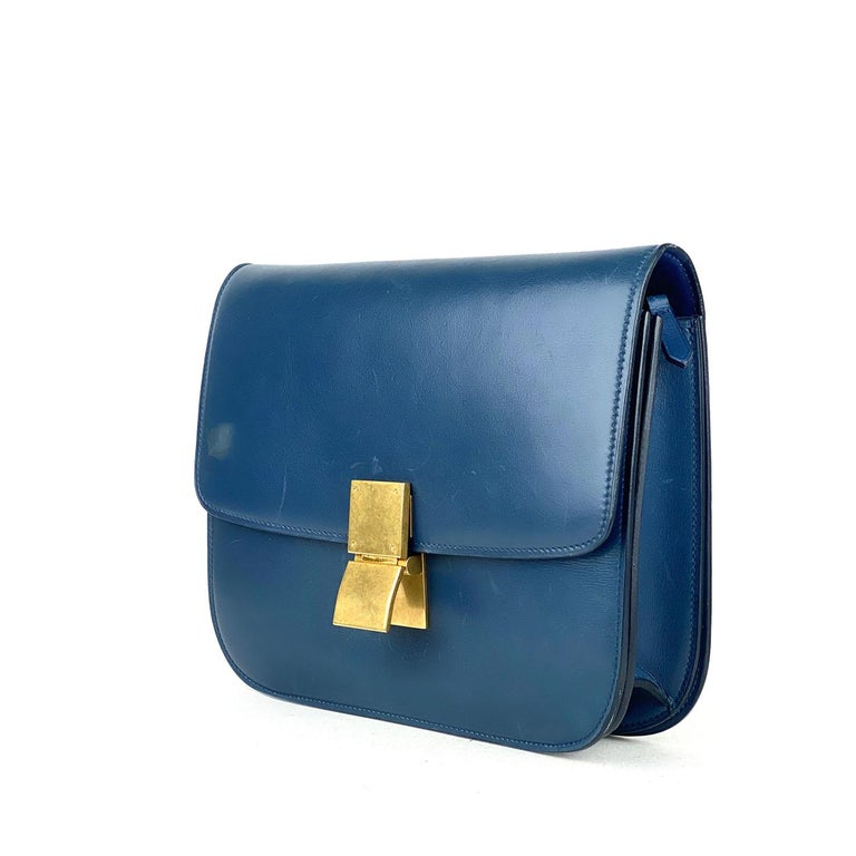 Blue Box calfskin Celine Medium Classic Box bag with  – Antiqued gold-tone hardware – Single flat shoulder strap – Dual interior compartments, three pockets at interior walls; one with zip closure and push-lock closure at front flap  Overall