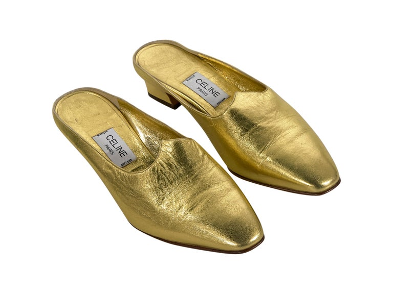 Product details:  Vintage metallic gold leather mules by Celine.  Round toe.  Slip-on style.  1.5