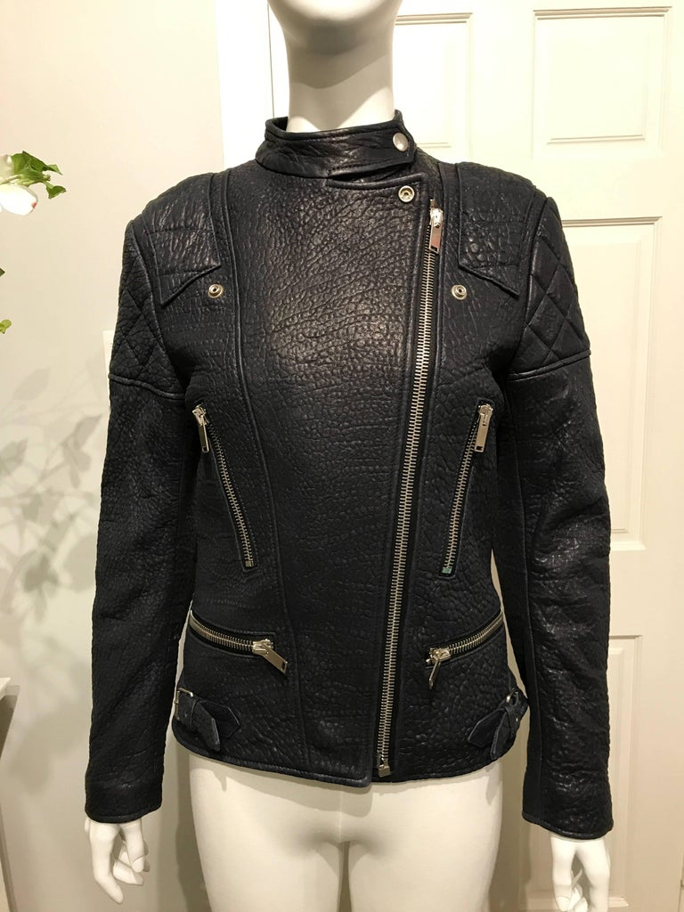 Céline biker jacket in midnight blue pebbled lambs-leather with red quilted lining. Shoulders, upper arms and elbow patches in quilted leather. Silver hardware.  New with tags.