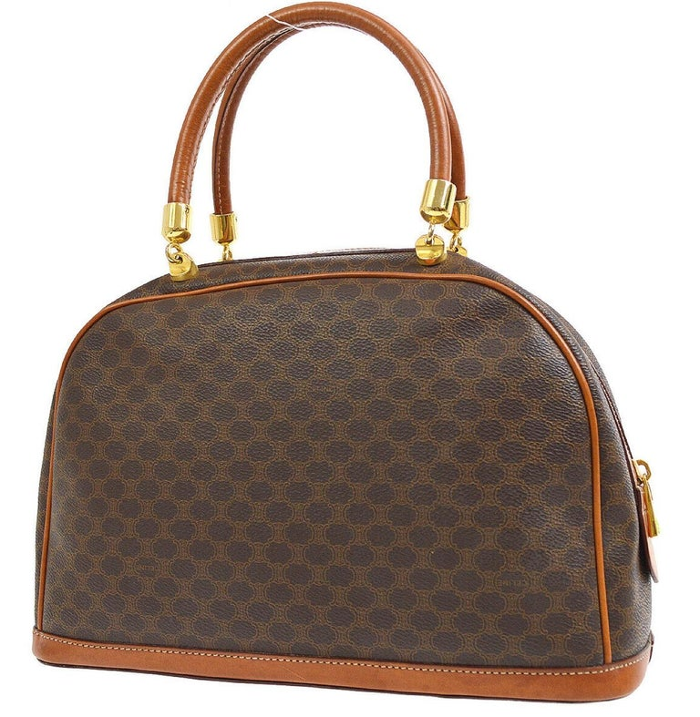 Monogram canvas Leather trim Leather lining Gold tone hardware Handle drop 6