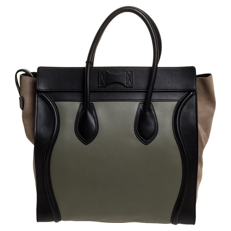 This popular Luggage tote from Celine can now be yours. This tote is crafted from leather and suede. It comes with rolled top handles and a front zip pocket. The bag is equipped with a well-sized leather interior for you to carry your essentials.