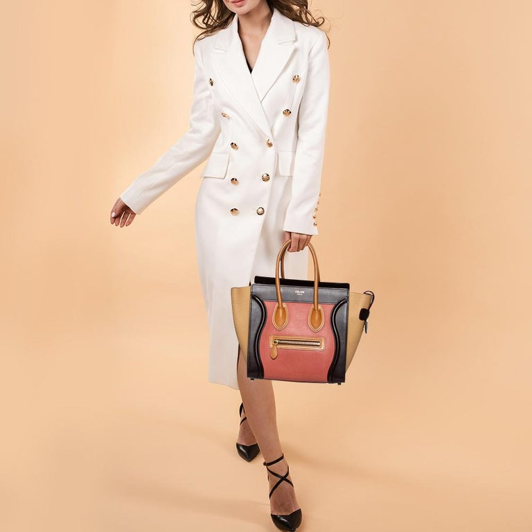 The micro Luggage tote from Celine is one of the most popular handbags in the world. This tote is crafted from leather and designed in multcolors. It comes with rolled top handles and a front zip pocket. The bag is equipped with a well-sized leather