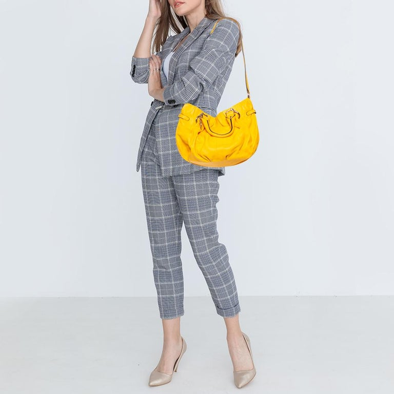 Meticulously created, this tote by Celine is a style statement in itself. Designed from leather into a slouchy shape, it exudes style and class in equal measures. This delightful yellow-hued piece is held by two top handles and equipped with a