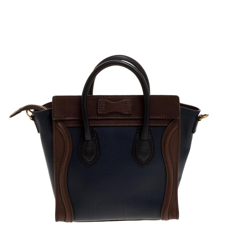 The Nano Luggage tote from Celine is one of the most popular handbags in the world. This tote is crafted from leather and designed in a navy blue shade. It comes with rolled top handles, a detachable shoulder strap and a front zip pocket. The bag is