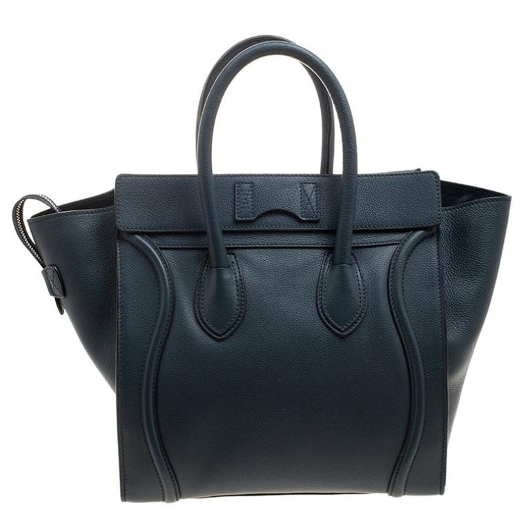 The Mini Luggage tote from Celine is one of the most popular handbags in the world. This tote is crafted from leather and it features a classy navy blue exterior with the signature flappy wings. It comes with rolled top handles, front zip pocket,