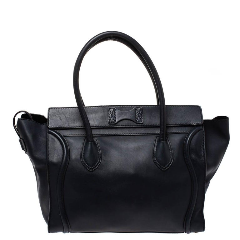 The Luggage tote from Celine is one of the most popular handbags in the world. This tote is crafted from leather and designed in a navy blue shade. It comes with rolled top handles, protective metal feet and a front zip pocket. The bag is equipped