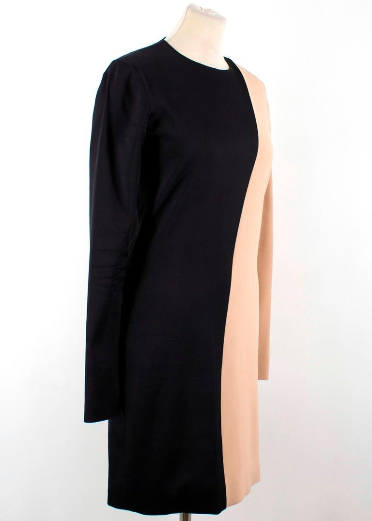 Celine Nude and Black Colour Block Mini Dress  -Nude and black colour block dress -Minidress with long sleeves -Zip closure -Scoop neckline -Zips on cuffs  Please note, these items are pre-owned and may show signs of being stored even when unworn
