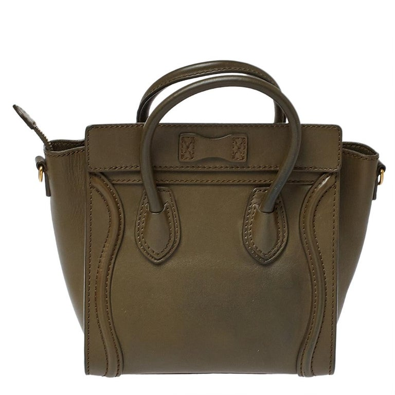 The Nano Luggage tote from Celine is one of the most popular handbags in the world. This tote is crafted from leather and designed in an olive green shade. It comes with rolled top handles, a detachable shoulder strap, and a front zip pocket. The