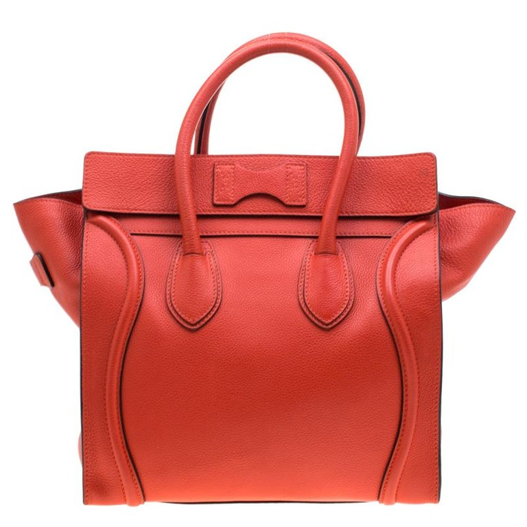 The mini Luggage tote from Celine is one of the most popular handbags in the world. This tote is crafted from leather and designed in an orange shade. It comes with rolled top handles and a front zip pocket. The bag is equipped with a well-sized