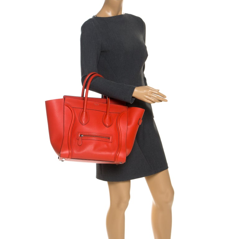 The mini Luggage tote from Celine is one of the most popular handbags in the world. This tote is crafted from leather and designed in n orange shade. It comes with rolled top handles and a front zip pocket. The bag is equipped with a well-sized