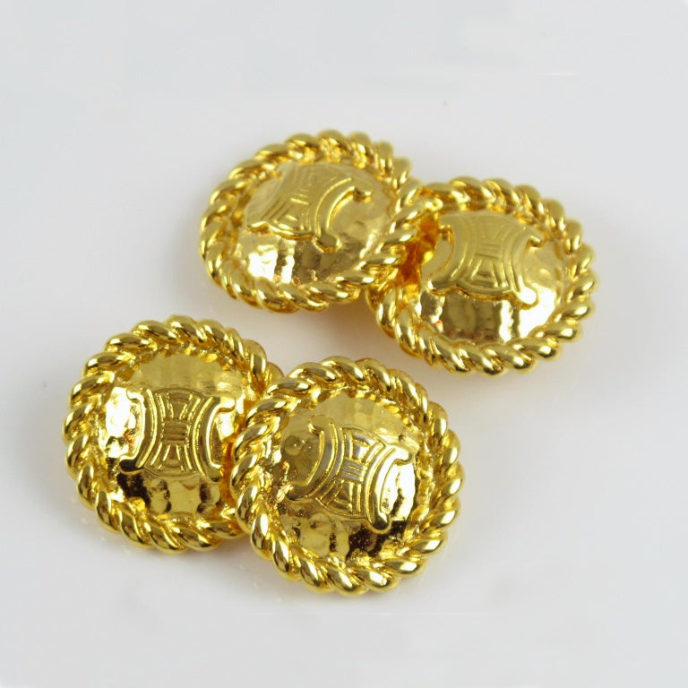 Lovely Celine Paris signed cufflinks. Rounded shape with shiny gilt metal with braided framing topped with engraved Celine brand logo. Marked at the back: 'Made in Italy'. Nice quality garment accessory. Perfect for clothing such as jacket, sweater,