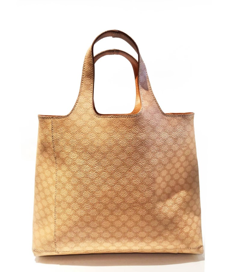 Very rare Celine Paris tote leather bag, beige and brown Madacan print, leather trim, double handles, an open top, and an interior zip compartment and pocket, beautiful logo on front side.  Condition: very good vintage, light sign of wear on one