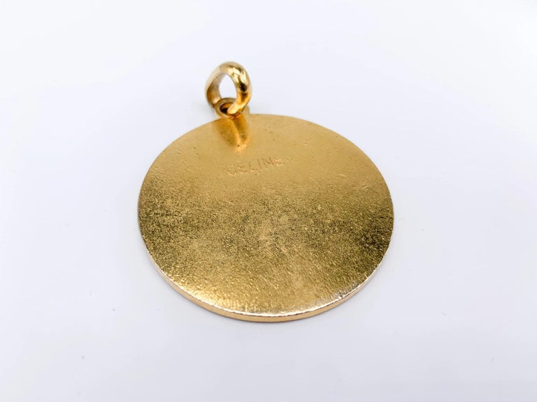 Celine 1970s Vintage Pendant.   Super cool large pendant from the 70s archive of the iconic House of Celine.   Detail -Gold plated metal -Inlaid with black enamel -Features the iconic macadam Celine logo  Authenticity & Condition -Fully examined and
