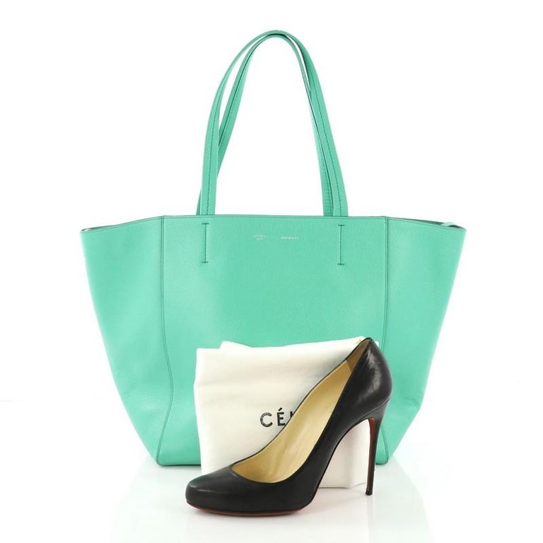bc2a35f9d This Celine Phantom Cabas Tote Leather Small, crafted in green leather,  features dual slim