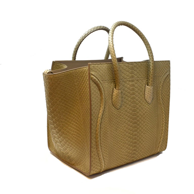 Brilliance Jewels, Miami Questions? Call Us Anytime! 786,482,8100  Brand: Celine  Model Name: Phantom Luggage  Material: Python Snakeskin  Width: 30 inches  Height: 30 inches  Depth: 9.5 inches  Handle Drop: 5 inches  Condition: Minor Wear and Tear