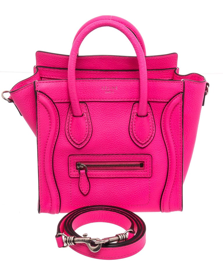 Pink leather Céline Nano Luggage tote with silver-tone hardware, dual rolled top handles, detachable flat shoulder strap, zip pocket at front, tonal hide interior, single slip pocket at interior wall and zip closure at top.   22079MSC