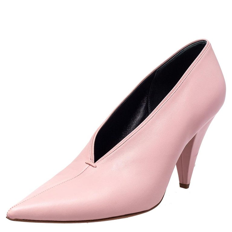You are sure to admire this pair of V Neck pumps from Celine. The exterior of these sandals has been crafted from Nappa leather and is designed with a V-shaped cut at the vamps. They feature pointed toes and 10 cm heels.  Includes: Original Box,