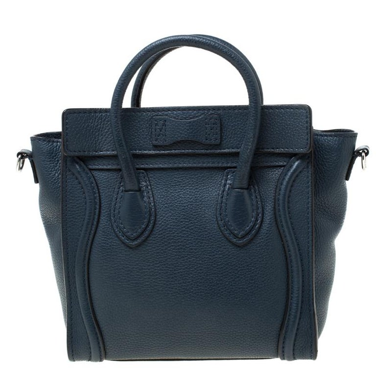 The Nano Luggage tote from Celine is one of the most popular handbags in the world. This tote is crafted from leather and designed in a blue shade. It comes with rolled top handles, a detachable shoulder strap, and a front zip pocket. The bag is