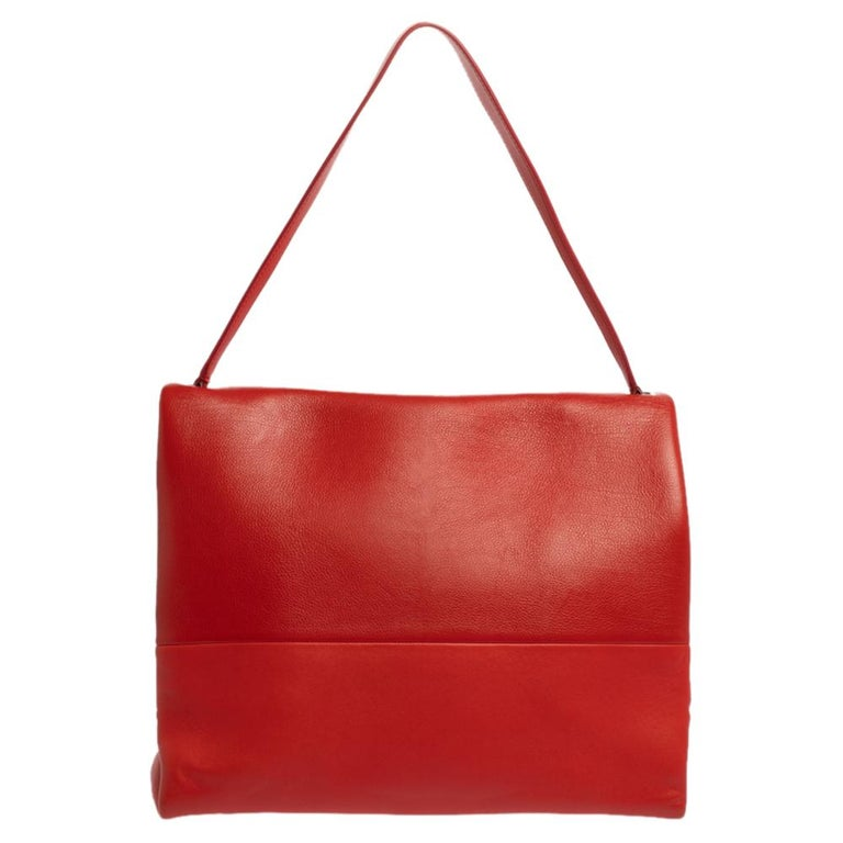 Minimalist charm for the everyday woman reigns the chic brand, Céline. This Celine All Soft shoulder bag with a striking look is perfect for the modern woman. Crafted from red-colored leather, this minimalist tote features a single shoulder strap,
