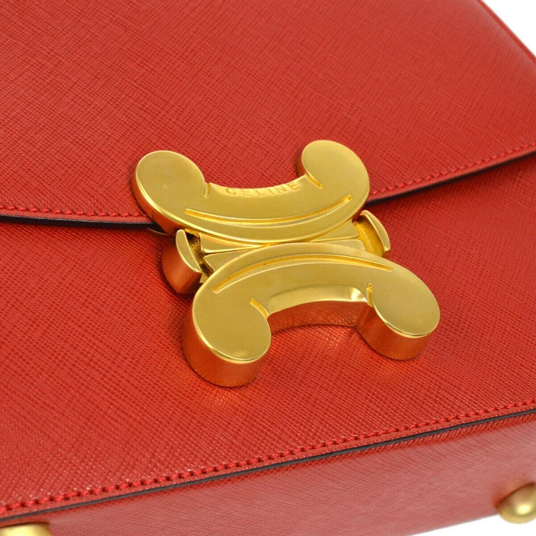 Leather Gold tone hardware Leather lining Flip lock closure Made in Italy Handle drop 4