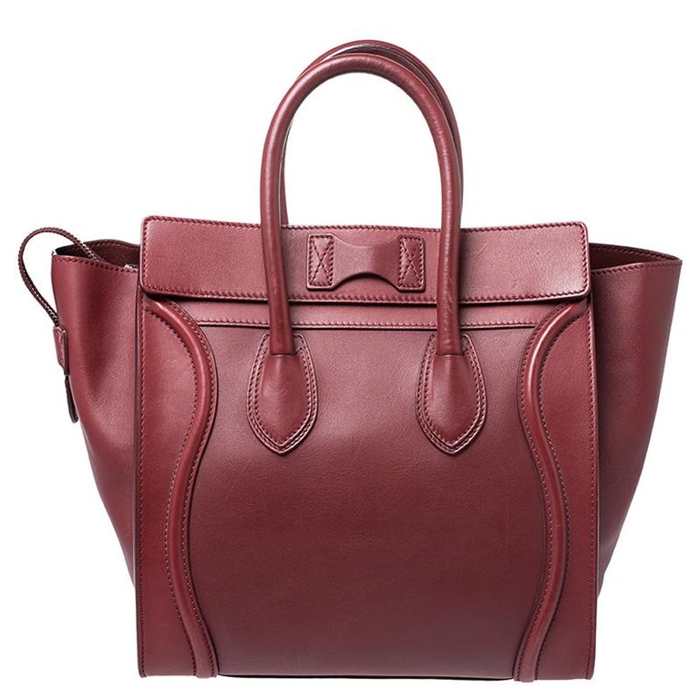 The mini Luggage tote from Celine is one of the most popular handbags in the world. This tote is crafted from leather and designed in a red shade. It comes with rolled top handles, protective metal feet and a front zip pocket. The bag is equipped