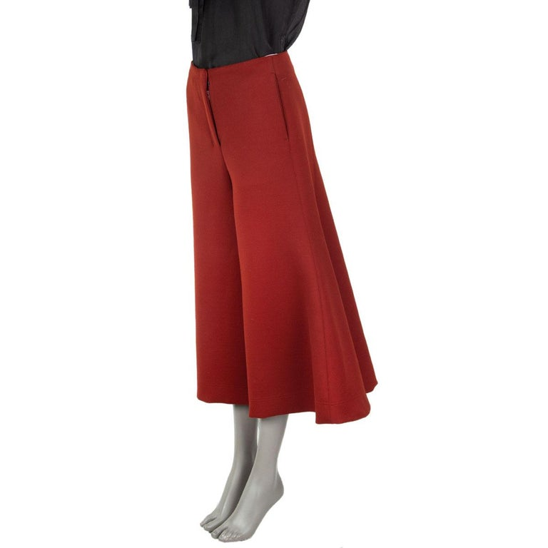 authentic Celine cropped wide-leg bell pants in rust virgin wool (75%) polyamide (23%) elastane (2%) with a high rise, mid-weight and two slit-pockets in the front. Unlined. Closes with a concealed zipper and two hooks & bar in the front. Has been