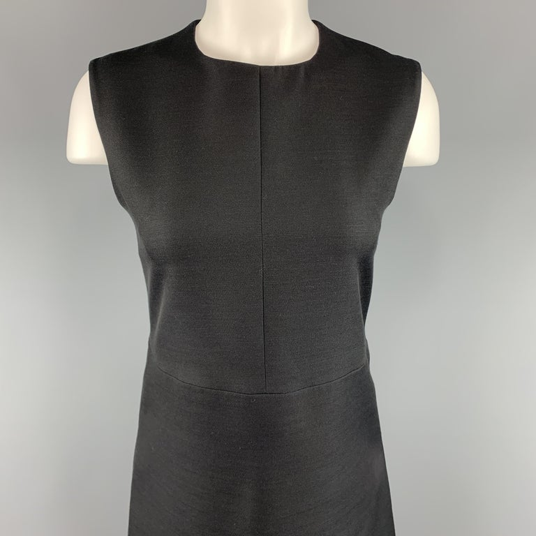 CELINE shift dress comes in a structured woven fabric with a round neckline and A line skirt silhouette. Silk lined. Made in France.  Excellent Pre-Owned Condition. Marked: FR 38  Measurements:  Shoulder: 14.5 in. Bust: 33 in. Waist: 30 in. Hip: 38