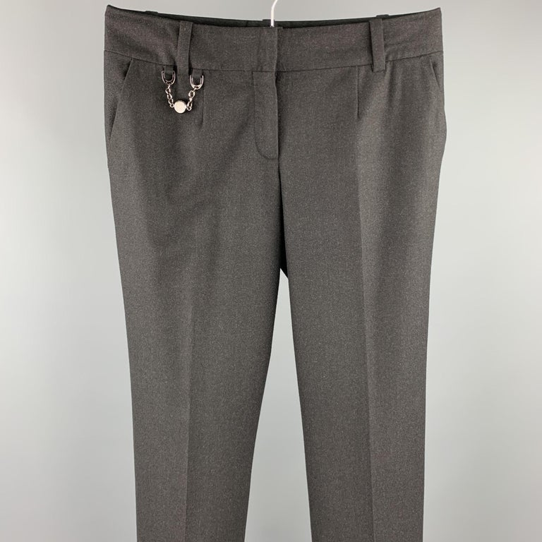 CELINE dress pants comes in a charcoal wool / elastane featuring a wide leg, metal chain detail, and a zip fly closure.   Excellent Pre-Owned Condition. Marked: 40  Measurements:  Waist: 32 in.  Rise: 7.5 in.  Inseam: 31 in.
