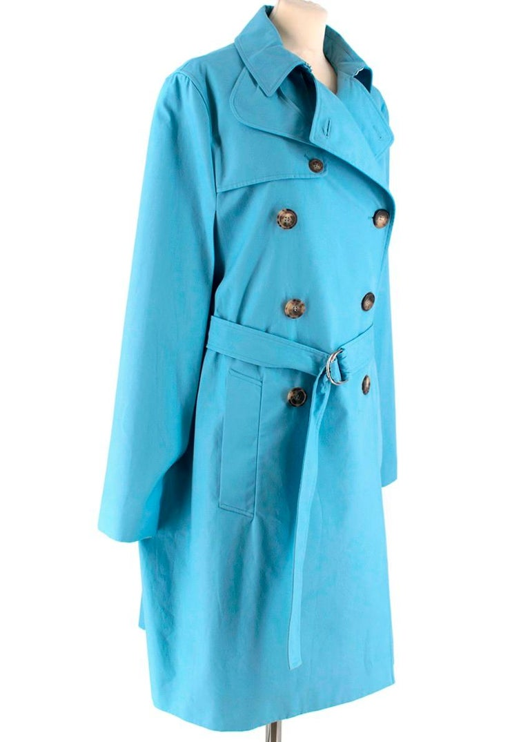 Celine Sky Blue Cape Trench Coat  - Double Breasted  - Tortoiseshell Large Buttons - Belt with silver-tone fastener  - Cape style sleeves attached to main body - 100% Heavy cotton  - 2 Pockets  - Pointed collar  - Hook fastening around collar -