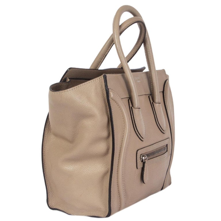 Céline 'Micro Luggage' in off-white, beige and sage grey calfskin. Opens with a zipper on top and is lined in beige calfskin with one zipper pocket against the back and two open pockets against the front. Has been carried with some pen marks on the