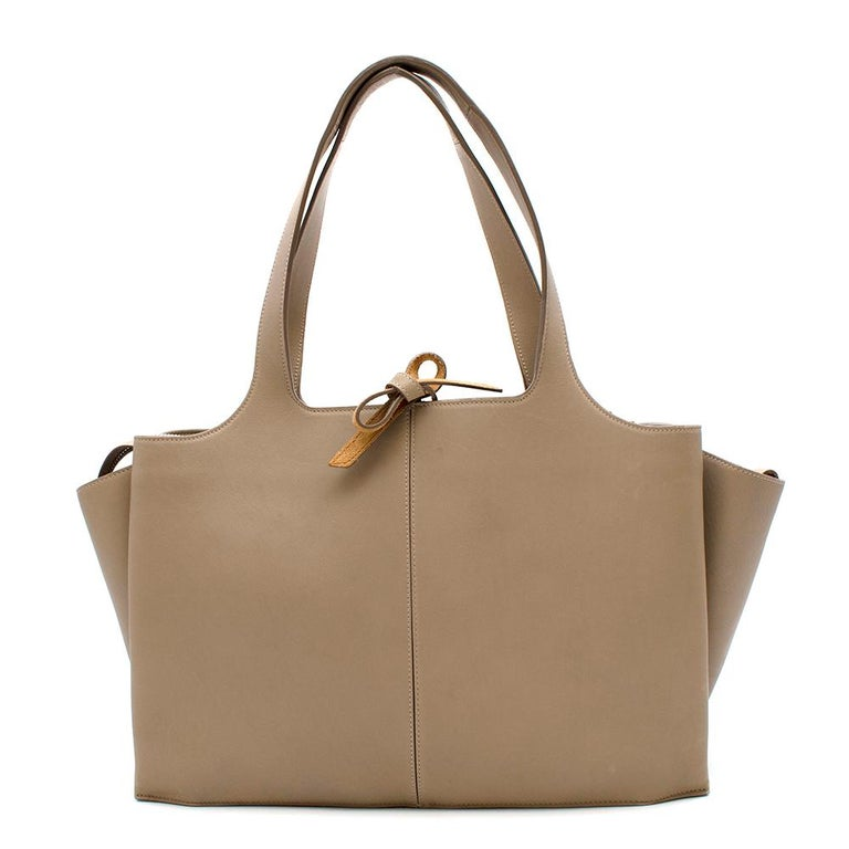 Celine Medium Pale Beige Tote  - Smooth calfskin with structure - Very spacious bag with zipped middle compartment & attached card holders - Tanned suede - Tied panel for security - Boxy look with signature overflowing side panels - Light silver