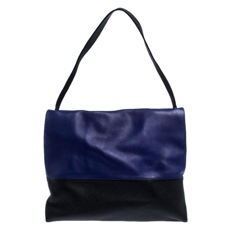 Minimalist charm for the everyday woman reigns the chic brand, Céline. This Celine All Soft shoulder bag with a neutral and understated look perfect for the modern woman. Crafted from blue, black and grey-colored leather, this minimalist tote