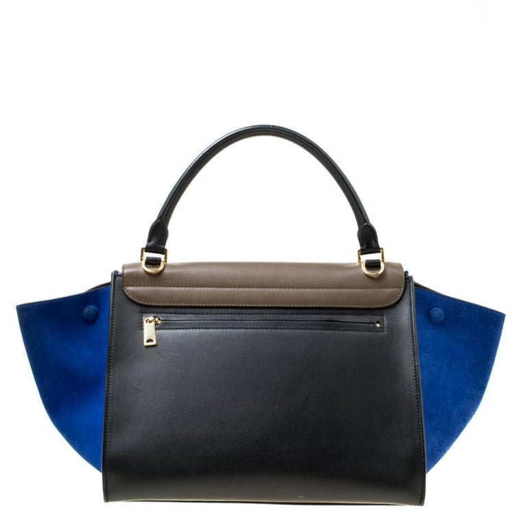 A popular design amongst Celine bags is the Trapeze which is still a common sight in the handbag scene. Here, we have the one in three colours. Crafted from leather and suede in Italy, the bag is designed to catch glances from a mile. It has the