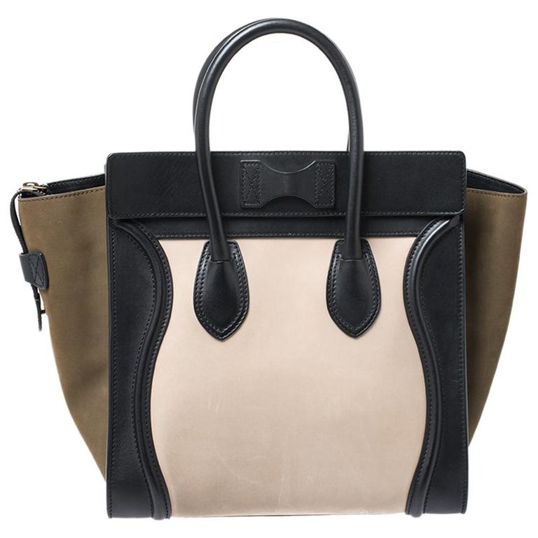 The mini Luggage tote from Celine is one of the most popular handbags in the world. This tote is crafted from leather and suede and designed in a tri color. It comes with rolled top handles and a front zip pocket. The bag is equipped with a