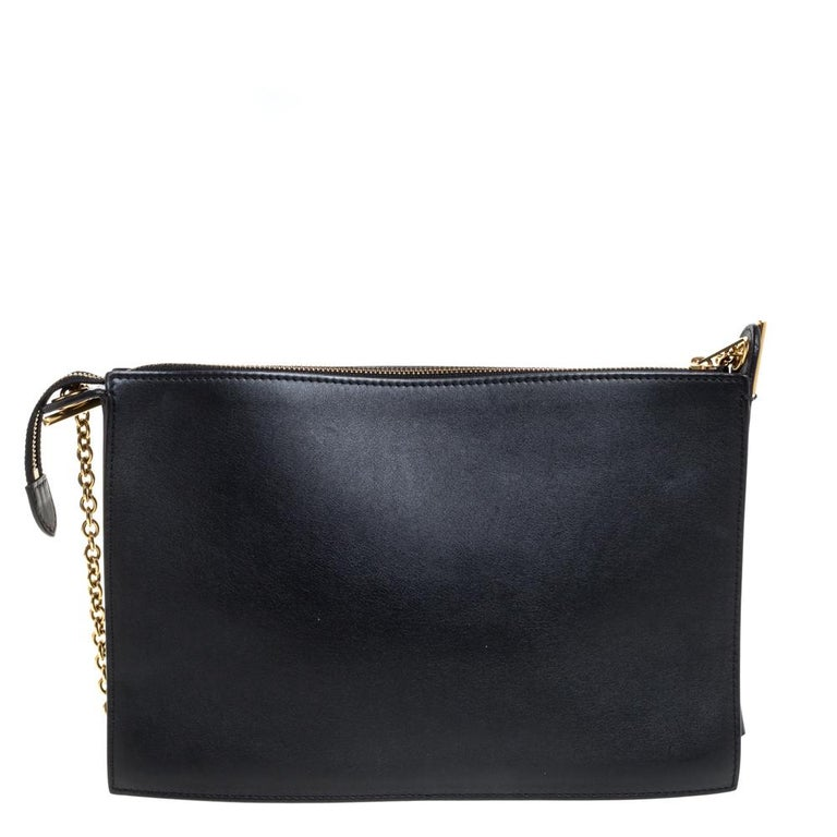 This splendid bag from Celine is crafted from leather in a tricolor palette and features a front pocket. It has a top zip closure that opens to a spacious leather interior capable of holding your daily essentials. It is complete with a gold-tone