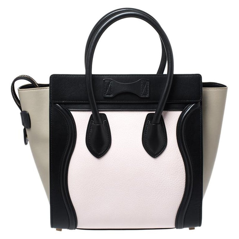 The mini Luggage tote from Celine is one of the most popular handbags in the world. This tote is crafted from leather and designed in a tri color. It comes with rolled top handles and a front zip pocket. The bag is equipped with a well-sized suede