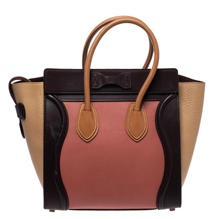 The mini Luggage tote from Celine is one of the most popular handbags in the world. This tote is crafted from leather and designed in lovely shades. It comes with rolled top handles, gold-tone and a front zip pocket. The bag is equipped with a