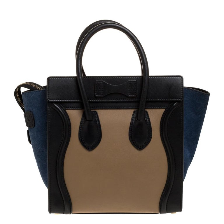 The micro Luggage tote from Celine is one of the most popular handbags in the world. This tote is crafted from leather and suede and designed in lovely shades. It comes with rolled top handles, metal feet at the bottom, and a front zip pocket. The