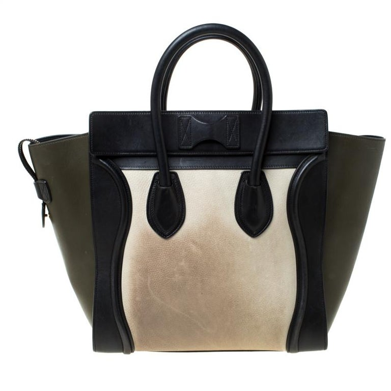 The mini Luggage tote from Celine is one of the most popular handbags in the world. This tri-color tote is crafted from leather. It comes with rolled top handles, a and a front zip pocket. The bag is equipped with a well-sized leather and nubuck