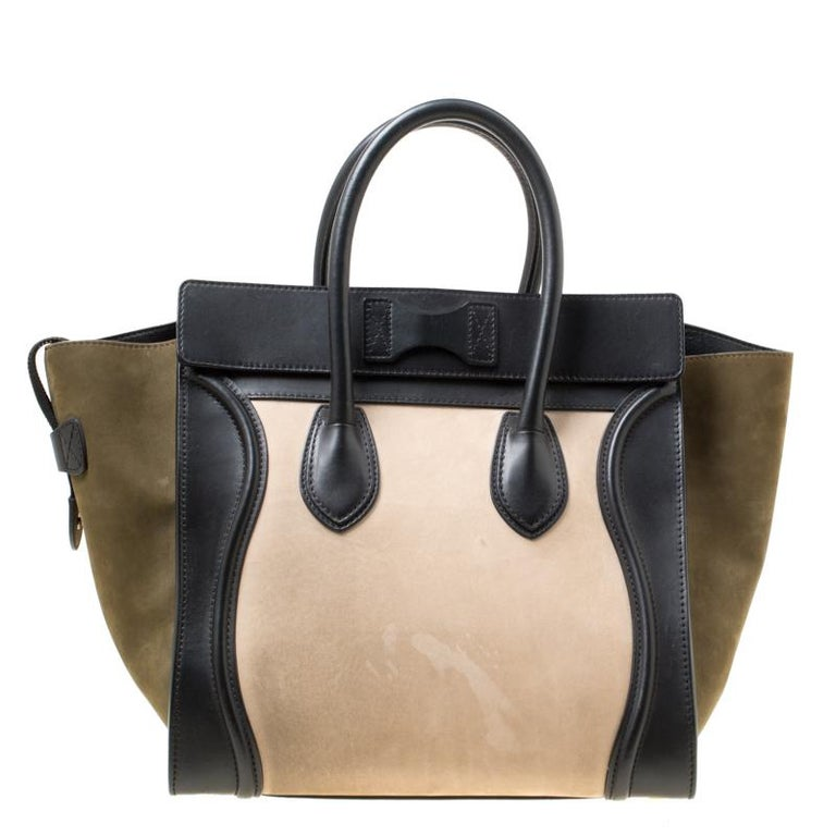 The iconic Mini Luggage tote from the house of Celine has had a cult following ever since its introduction. Featuring a chic trapeze shape, this bag is crafted in tri-colour nubuck and leather with wings, two rolled top handles and secured with a