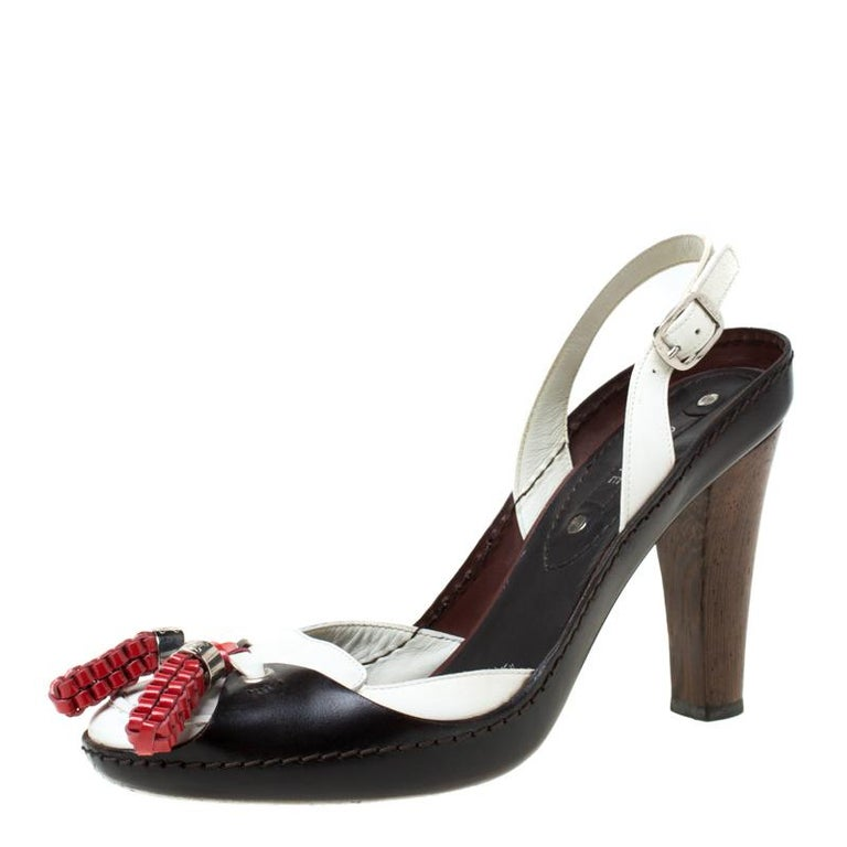 Gorgeous and comfortable, this pair of sandals is brought to you by Celine. Made of tricolor leather, they come in a slingback design with tassel detail on the uppers and 9.5 cm heels to lift your steps.