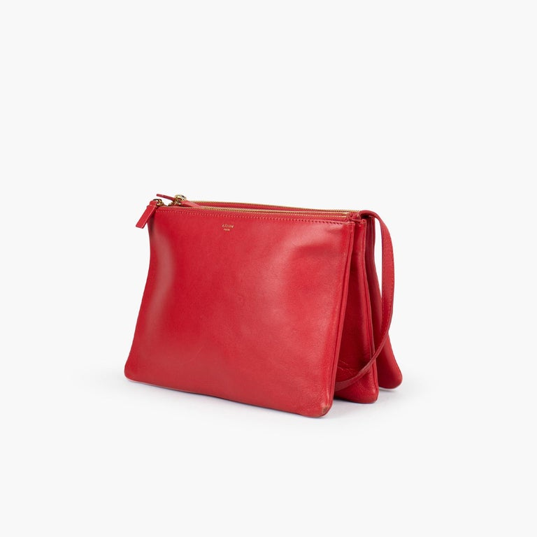 Red Large Celine Trio Crossbody Bag  - Gold-Tone Hardware - Tan vachetta leather trim - Single Adjustable Shoulder Strap - Tonal canvas lining and two-way zip closure at top - Felt Lining - Zip Closure at Top  Overall Preloved Condition: