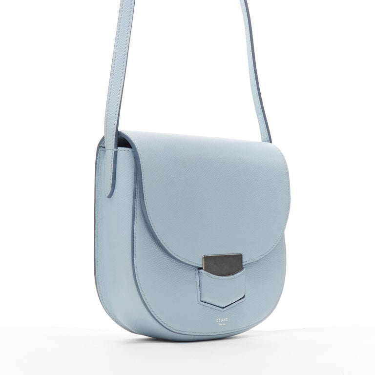 CELINE Trotteur pool light blue leather flap front rounded base shoulder bag Brand: Celine Designer: Phoebe Philo Model Name / Style: Trotteur Material: Leather Color: Blue Pattern: Solid Extra Detail: Trotteur small. Silver-hardware.  CONDITION: