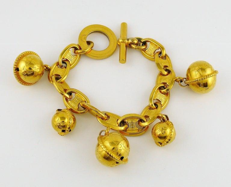 Celine Vintage 1990 Iconic Gold Toned Planisphere Charm Bracelet For Sale 4