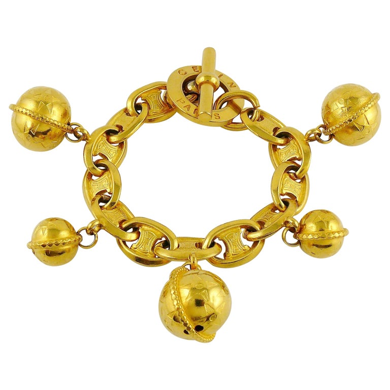 Celine Vintage 1990 Iconic Gold Toned Planisphere Charm Bracelet For Sale